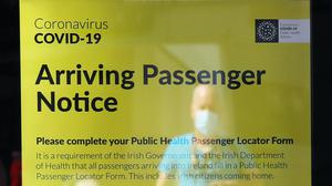 A notice for arriving passengers regarding the Covid-19 Passenger Locator Form at Terminal 2 in Dublin Airport (Brian Lawless/PA)