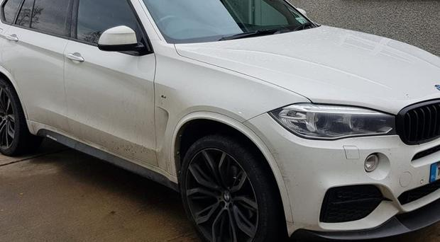 Cars and cash were seized in Co Monaghan, near the Irish border, as part of a probe into a suspected international smuggling operation (Criminal Assets Bureau/PA)