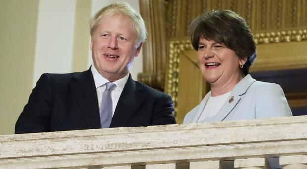 Boris Johnson with DUP leader Arlene Foster (Niall Carson/PA)
