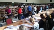 Counting staff during the Irish General Election count at the Nemo Rangers GAA Club in Cork (Yui Mok/PA)