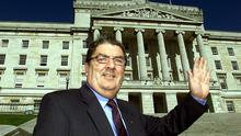 John Hume in front of the Stormont Building in 2002 (Paul Faith/PA)