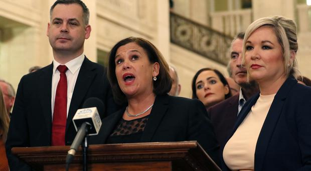 Sinn Fein President Mary Lou McDonald (centre), deputy leader Michelle O'Neill (right) and party colleagues speak to the media at Stormont (Brian Lawless/PA)