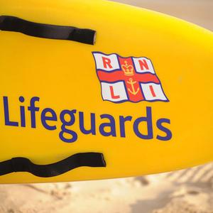 The RNLI helped rescue three people after their speedboat filled with water