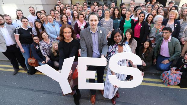 Simon Harris, centre,, at the launch of Doctors for Yes in Dublin