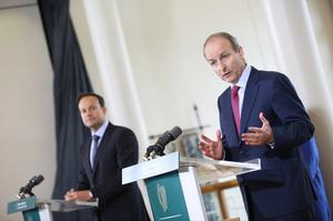 Micheal Martin (right) is to unveil proposals in July (Julien Behal/PA)