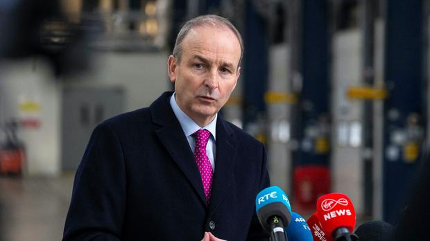 Taoiseach Micheal Martin speaking to media during a visit to Dublin Port (Julien Behal/PA)