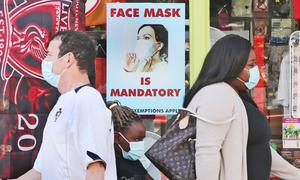 People wearing facemasks in Athy, Co Kildare (Niall Carson/PA)
