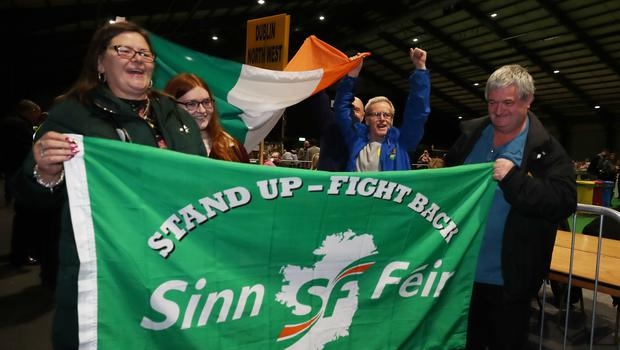 Sinn Fein supporters celebrate as ballot papers are counted at the RDS in Dublin during the Irish General Election count (PA)