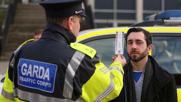 Actor Jonathan Walsh is given a pupil dilation test by a garda at the launch of new measures to combat drug and drink-driving at University College Dublin