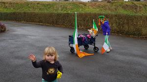 Children creating their own St Patrick's Day parade at their home in Donegal (Donal O Faogain/Twitter)
