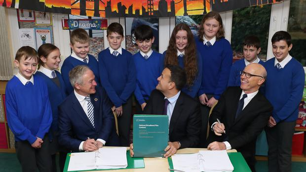 (left to right) Communications Minister Richard Bruton, Taoiseach Leo Varadkar and US business man David McCourt who leads The Irish Broadband consortium sign the National Broadband plan at St Kevin???s National School in Co Wicklow.