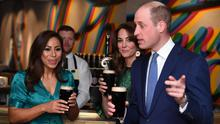 The Duke and Duchess of Cambridge hold a pint of Guinness each (James Whatling/PA)