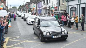 The hearse with the body of Detective Garda Colm Horkan arrives in Ballaghaderreen in County Roscommon on Friday evening.