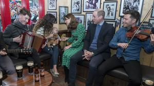 The Duke and Duchess of Cambridge meet locals during a visit to a traditional Irish pub in Galway (Arthur Edwards/The Sun/PA)