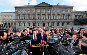 Fianna Fail leader Micheal Martin (centre) with party TD's, speaks to the media on the plinth at Leinster House, Dublin, for the first sitting of the 33rd Dail