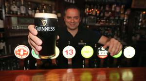 Mariusz Brzyk, assistant manager of Paddy Cullen's pub in Dublin, holds a fresh Guinness in preparation for bars re-opening in the UK and Ireland (Niall Carson/PA)
