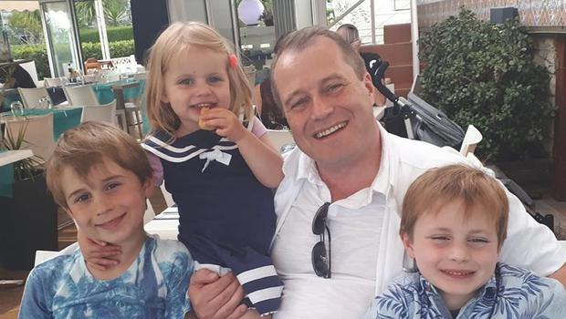 Conor McGinley, nine, Darragh McGinley, seven, and Carla McGinley, three, with their father Andrew McGinley (Garda/PA)