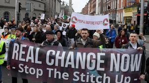 People take part in a march in Dublin's city centre (Brian Lawless/PA)