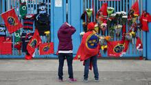Munster Rugby fans place tributes outside Thomond Park in Limerick after the death of head coach Anthony Foley