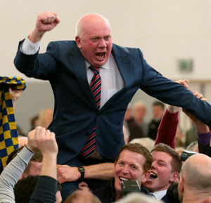 Fianna Fail's Jackie Cahill is hoisted into the air as he celebrates being elected TD in Tipperary
