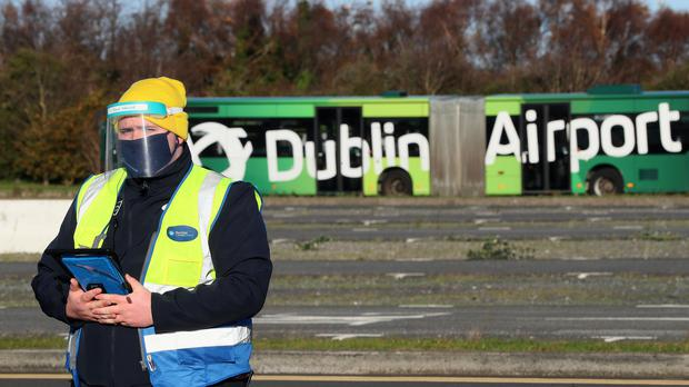 A RocDoc employee at the opening of its drive-through Covid-19 testing facility at Dublin Airport (Brian Lawless/PA)