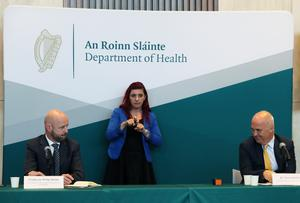 Dr Tony Holohan, Chief Medical Officer, and Professor Philip Nolan speak during a virus update briefing (Brian Lawless/PA)