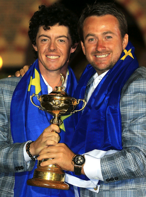 Rory McIlroy and Graeme McDowell celebrate together after winning the Ryder Cup in 2012