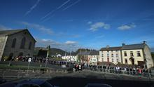 People queue up to pay their respects to the family of Munster Rugby head coach Anthony Foley at St. Flannan's Church, Killaloe in Co Clare