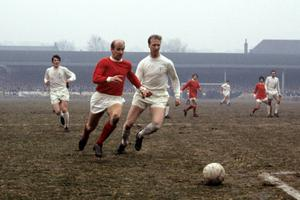 Brothers Bobby and Jack Charlton playing for Manchester United and Leeds (PA)