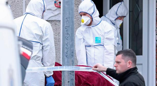 Forensics officers remove the body of 11-year-old Brooklyn Colbert from a house in Limerick