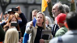 Gemma O'Doherty (centre) and John Waters (right) speak to supporters outside the High Court in Dublin where they have launched a legal challenge against the State over emergency laws and restrictions introduced to stop the spread of Covid-19 (Brian Lawless/PA)
