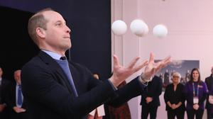 The Duke of Cambridge juggles during a special event at the Tribeton restaurant in Galway (Brian Lawless/PA)