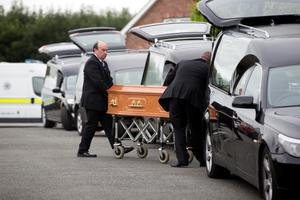 Five hearses arrive at the house at Barconey, Ballyjamesduff, in Cavan to remove the bodies for post-mortem