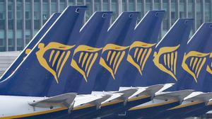Up to 3,000 jobs across pilots and cabin crew will be cut at Ryanair (Niall Carson/PA)