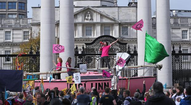 Protesters outside the Department of the Taoiseach during an Extinction Rebellion (XR) demonstration in Dublin, Ireland (Niall Carson/PA)