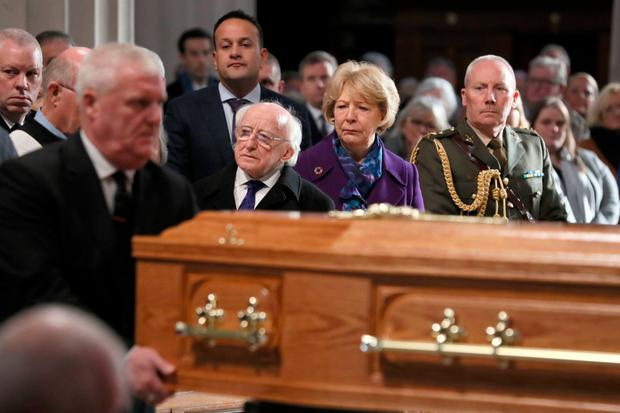 Irish President Michael D Higgins, his wife Sabina and Taoiseach Leo Varadkar watch as the coffin of Gay Byrne, is carried into St Mary's Pro-Cathedral