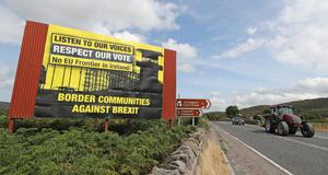 Anti-Brexit billboards on the northern side of the border between Newry in Northern Ireland and Dundalk in the Republic of Ireland (Niall Carson/PA)