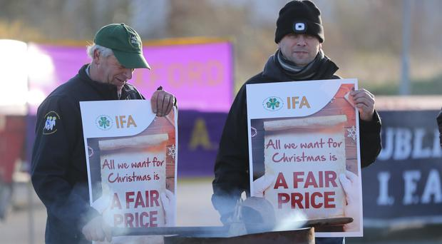 Members of the Irish Farmers' Association blockade the Tesco site in Donabate, Dublin, in protest over poor cattle prices (Niall Carson/PA)