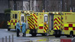 Medics in PPE and ambulances outside the Accident and Emergency department at the Mater Hospital in Dublin (Niall Carson/PA Wire)