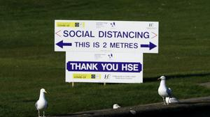A HSE sign encouraging Social Distancing (Brian Lawless/PA)