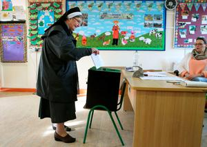 Sister Anastasia of the Franciscan Order casts her vote at Knock National school