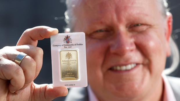 Nigel Doolin, Head of Trading at Core Bullion Traders, pictured with one of the Dublin Assay Office gold bullion bars (Conor McCabe Photography)