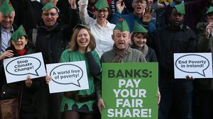 Karen Smith and Noel Collins (centre front) join a coalition of Irish civil organisations launching the Robin Hood Tax Campaign Ireland at the Mansion House in Dublin