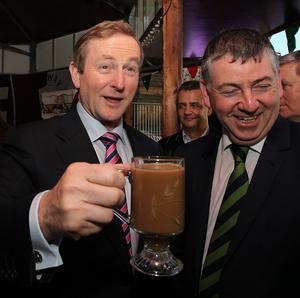 Taoiseach Enda Kenny has an Irish coffee outside the town hall in Manchester.