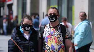 A couple wearing face masks shopping in Dublin's Henry Street (Niall Carson/PA)