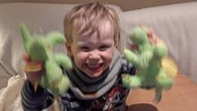 Jamie Bracken-Murphy holds the dragon toys he won after getting stuck in a toy machine