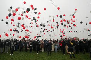 Friends and family of George Nkencho release the balloons (Niall Carson/PA)