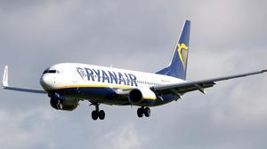 Ryanair this week reported a 21% fall in quarterly profits (Niall Carson/PA)
