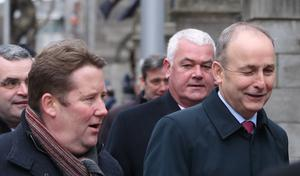 (left to right) Fianna Fail's Darragh O'Brien and Michael Martin (PA)