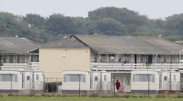 The Department of Justice has faced resistance to opening new direct provision centres (Niall Carson/PA)